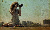 Young girl with a camera — Stock Photo