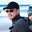 Dad with small child walking on a winter beach. — Stock Photo #8761346