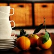 Stock Photo: White cups and organic oranges. soft Focus