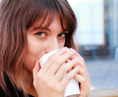 Young girl with a cup of coffee — Stock Photo