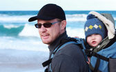 Dad with small child walking on a winter beach. — Stock Photo