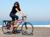 Beautiful woman with bicycle — Stock Photo