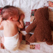 Stock Photo: 5 days old baby with toy