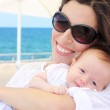 Fashionable young mother with her little baby — Stock Photo #8995799