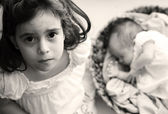 5-year-old girl with her newborn sister — Stok fotoğraf