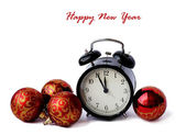 Red Christmas balls and alarm clock. 5 minutes before the New Ye — Stock Photo