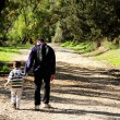 Father and son walking in spring forest — Stock Photo