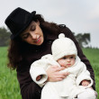 Mother and child walking in the park on a cloudy day — Stock Photo