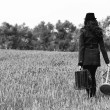 Girl in the field. Photo in old color image style. — Stock Photo #9833951