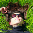 Beautiful Woman lying on the green grass — Stock Photo