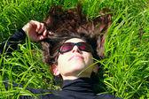 Beautiful Woman lying on the green grass — Stock Photo