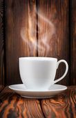 White cup with steaming hot drink — Stock Photo
