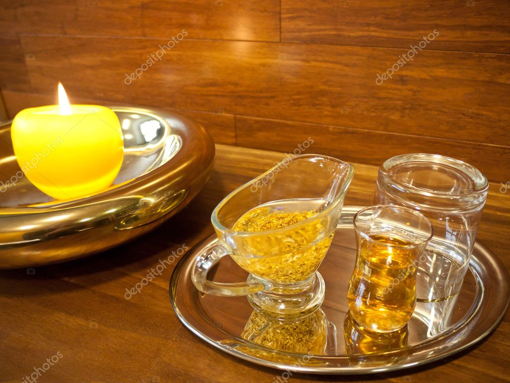 Equipment for luxurious spa treatments with golden oil and honey in a glasses  Stock Photo #10083465