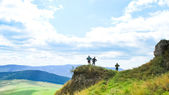 Three tourists on viewpoint — Stock Photo