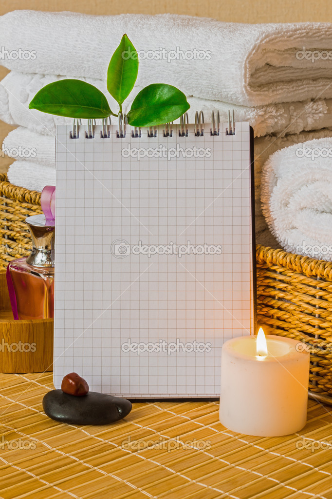 Spa with towels with a candle and pad — Stok fotoğraf #10297741