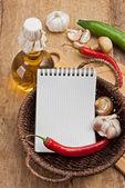 Bottle of sunflower oil and vegetables — Stock Photo