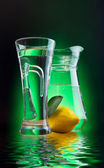 Mineral water and lemon — Stock Photo