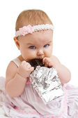 Little Girl with a chocolate bar — Stock Photo