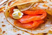 Pancakes with smoked salmon and butter on Shrovetide — Stock Photo