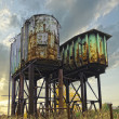Two rusty industrial barrels — Stok fotoğraf