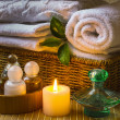 Spa with towels and candle — Stok fotoğraf