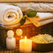 Spa with towels and candle — Stock Photo