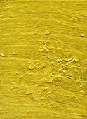 Gold paint on wooden panel — Stock Photo