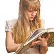 Blonde girl with opened big book — Stock Photo