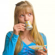 Blonde girl drink a cup of tea — Stock Photo