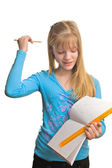 Blonde girl solve a mathematic homework — Stock Photo