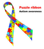Puzzle ribbon. Autism awareness symbol. — Stock Vector