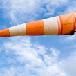 Full wind cone weather vane on windy day — Stock Photo