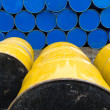 Stored stacks of colorful metal oil barrels - Foto de Stock