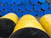 Stored stacks of colorful metal oil barrels — Stock Photo