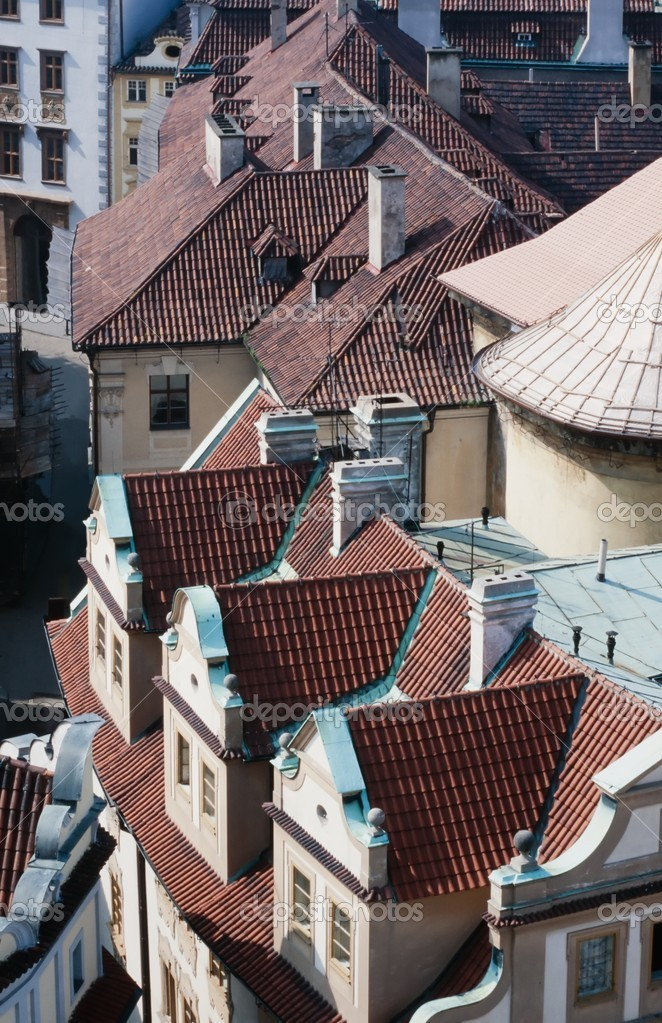 Overhead view looking down onto the tiled red rooftops of Prague, capital of Czechia, Europe  Stock Photo #10332950