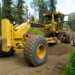 Grader resurfacing narrow rural road — Stock Photo #10449309