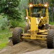 Grader resurfacing narrow rural road — Stock Photo #10449333