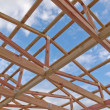 Stock Photo: Roof frame construction under cloudy blue sky