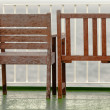 Two empty wooden chairs on balcony - Stockfoto