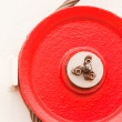 Stock Photo: Red fairlead pulley and steel cable
