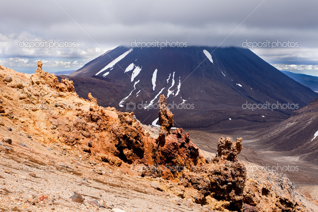Bizarre lava sculptures in front of active volcano cone of Mount Ngauruhoe as seen from Mount Tongariro in Tongariro National Park, North Island of New Zealand — Stock Photo #10510216