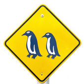 Attention Blue Penguin Crossing Road Sign — Stock Photo