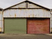 Grungy rusted corrugated iron garage doors — Stock Photo