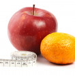 Red apple mandarine and measure tape — Stock Photo