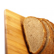 Sliced bread on board — Stock Photo #7972835