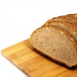 Sliced bread on board — Stock Photo #7972861