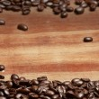 Coffee beans over grunge background — Stock Photo