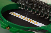 Success embroidery — Stock Photo