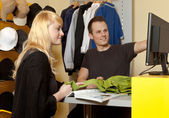 Small business: Portrait of a buyer and a shop assistant — Stock Photo