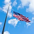 Half staff American flag — Stock Photo